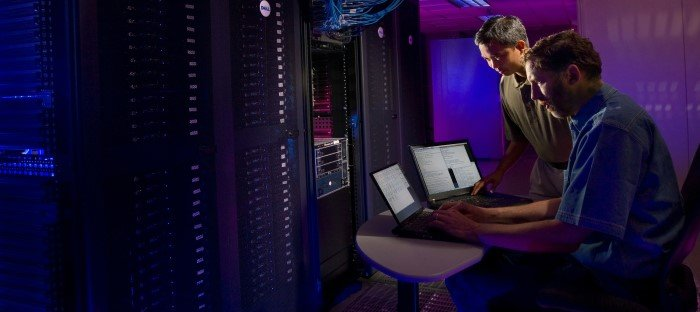 Photo of Network Engineers Working in Data Centre